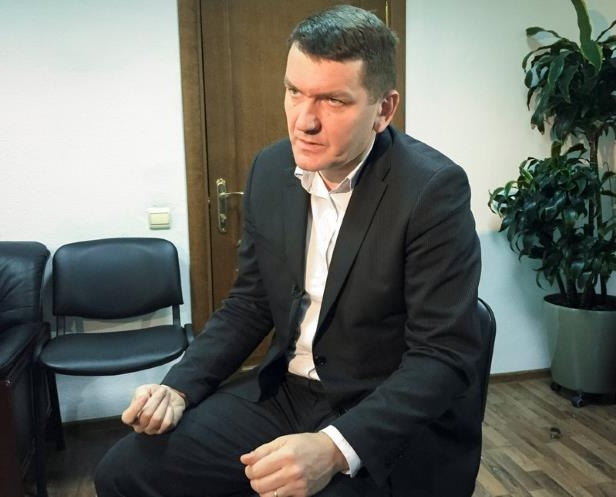 a man wearing a suit and tie: Serhii Horbatiuk, the head of Special Investigations at the General Prosecutor's Office of Ukraine, speaks during an interview with Reuters in Kiev