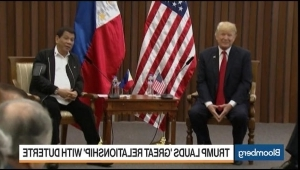 a man wearing a suit and tie: Trump Hails Great Relationship With Duterte