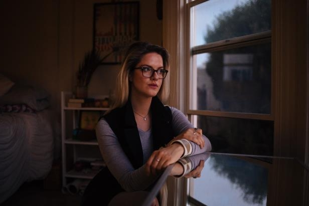 a woman standing in front of a window: Katherine Cichy says she was harassed by her direct supervisor while working for a Democratic senator's office in 2013.