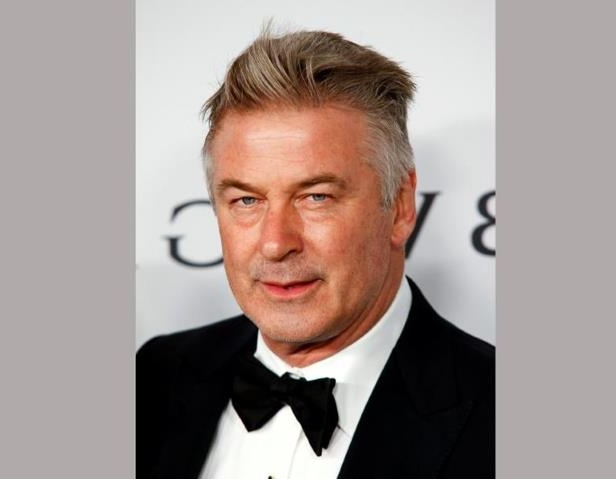Alec Baldwin wearing a suit and tie