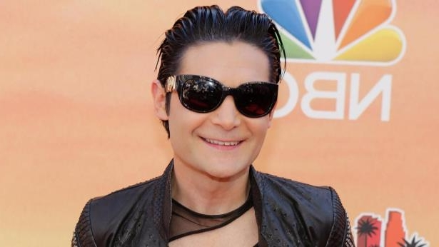 Corey Feldman wearing sunglasses posing for the camera: Fox411: Corey Feldman says two trucks apparently tried to run him over - all because he's working to expose 'a pedophilia ring' that's plagued Hollywood for decades.