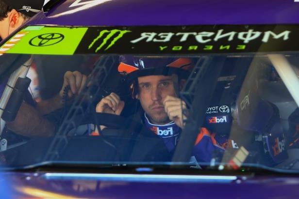 NASCAR Monster Energy Series driver Denny Hamlin puts his helmet on before practice ahead of Sunday's AAA Texas 500 on Saturday, Nov. 4 at Texas Motor Speedway in Fort Worth, Texas.