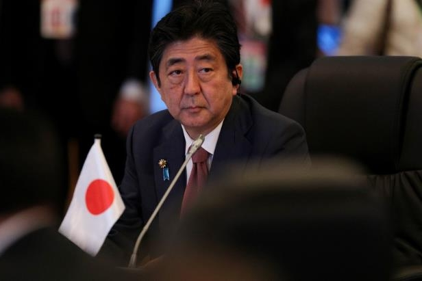 Shinzo Abe wearing a suit and tie: Japan's Prime Minister Shinzo Abe attends the opening session of the 20th ASEAN-JAPAN Summit in Manila.