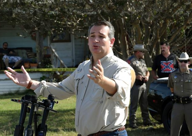 Slide 8 of 61: Senator Ted Cruz speaks to the media at the entrance to the First Baptist Church after a mass shooting that killed 26 people in Sutherland Springs, Texas on November 6, 2017. A gunman wearing all black armed with an assault rifle opened fire on a small-town Texas church during Sunday morning services, killing 26 people and wounding 20 more in the last mass shooting to shock the United States.