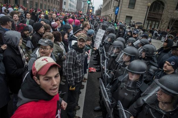 a large crowd of people: Officers in riot gear holding a line against protesters on Jan. 20 near the Capitol in Washington.