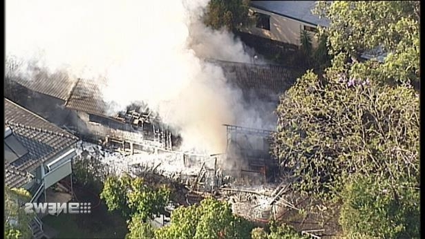 a train on a track with smoke coming out of it: <p>Two family dogs have died during a house fire in Kenmore.</p>