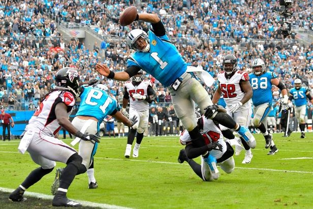 Slide 24 of 95: Cam Newton of the Carolina Panthers dives into the end zone for a touchdown during the second quarter of their game against the Atlanta Falcons at Bank of America Stadium on Nov. 5, 2017 in Charlotte, N.C.