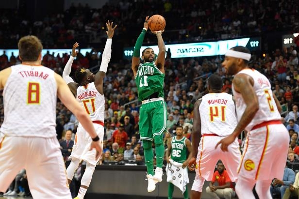 Slide 55 of 75: Boston Celtics guard Kyrie Irving (11) shoots a jump shot against the Atlanta Hawks during the second half at Philips Arena.