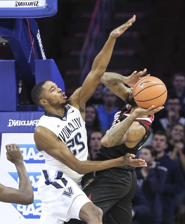 Villanova's Mikal Bridges tries to block Nicholls State's Roddy Peters during the first half of an NCAA college basketball game in Philadelphia, Tuesday, Nov. 14, 2017. (Steven M. Falk/The Philadelphia Inquirer via AP)