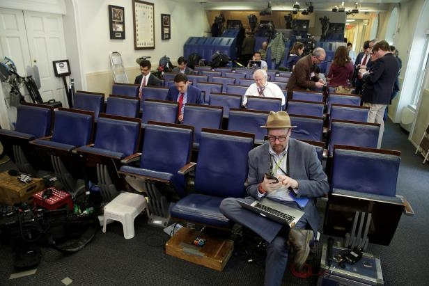 a group of people sitting at desks in a room: Glenn Thrush, who joined The New York Times in January to cover the Trump administration, has had one of the newspaper's most recognizable bylines.