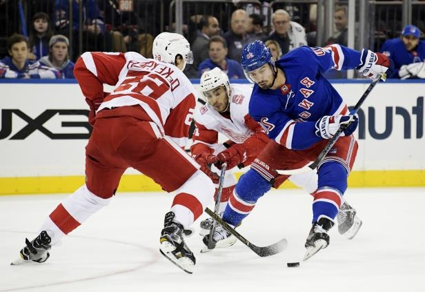 6d1c7b994 Slide 31 of 81  New York Rangers left wing Chris Kreider (20) makes. 31 81  SLIDES © Bill Kostroun AP Photo