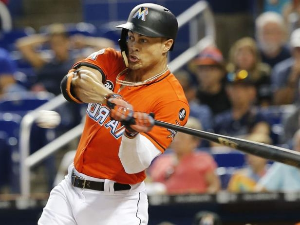 a man holding a baseball bat: The San Francisco Giants appear to be one of the front-runners to trade for National League MVP Giancarlo Stanton.