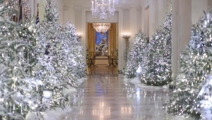a vase of flowers on a table: FLOTUS unveils White House Christmas decorations