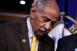 The growing push for John Conyers to resign, but not Al Franken, has some claiming racial bias