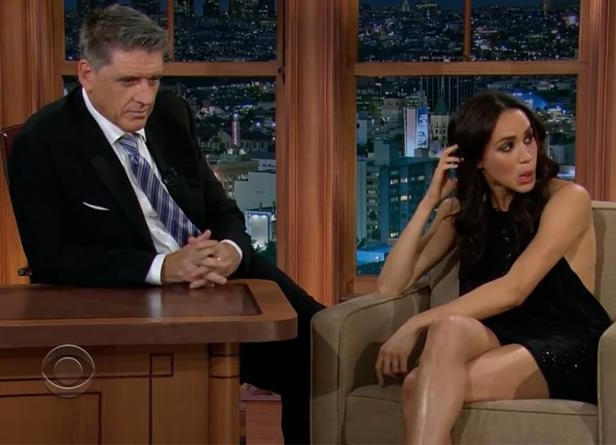 a man and a woman sitting on a table: Meghan Markle was interviewed by Craig Ferguson in 2013.