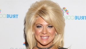 Theresa Caputo smiling for the camera: 'Long Island Medium' Theresa Caputo Splits From Husband Of 28 Years