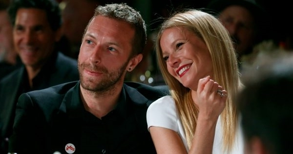 a man and a woman looking at the camera: Gwyneth Paltrow and Chris Martin pictured together in 2014. Image: Colin Young-Wolff /Invision/AP.