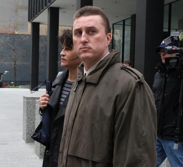 a man standing in front of a building: John Ambrose, a former U.S. marshal, was convicted of leaking government information to the mob in 2009.