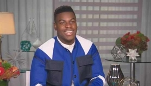 a man standing in front of a building: John Boyega Tells All on Filming