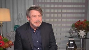 a man standing in front of a flower: Mark Hamill Gushes Over Billie Lourd in