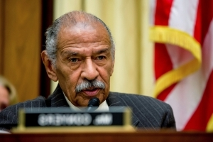 Woman says Rep. Conyers groped her while they were in church