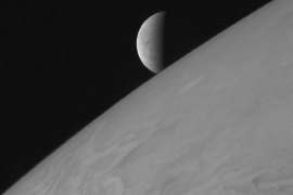 a close up of a logo: Europa makes its closest approach to Jupiter.