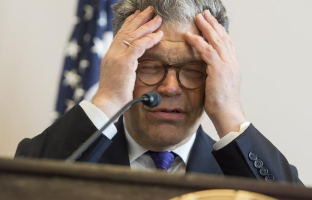 a man wearing a suit and tie: Sen. Al Franken (D-Minn.) speaks about net neutrality for the Internet during a discussion hosted by the Free Press Action Fund on Capitol Hill in Washington on July 8, 2014. (Saul Loeb/AFP/Getty Images)