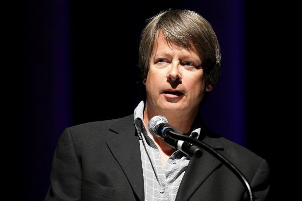 "a man wearing a suit and tie: The humor writer Dave Barry has 20 books on the approved list for Texas prisons, but one is banned. It includes ""criminal schemes,"" the state said."