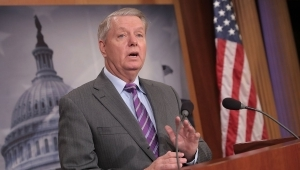 Lindsey Graham wearing a suit and tie: Sen. Lindsey Graham Wants Military Dependents Moved Out Of South Korea