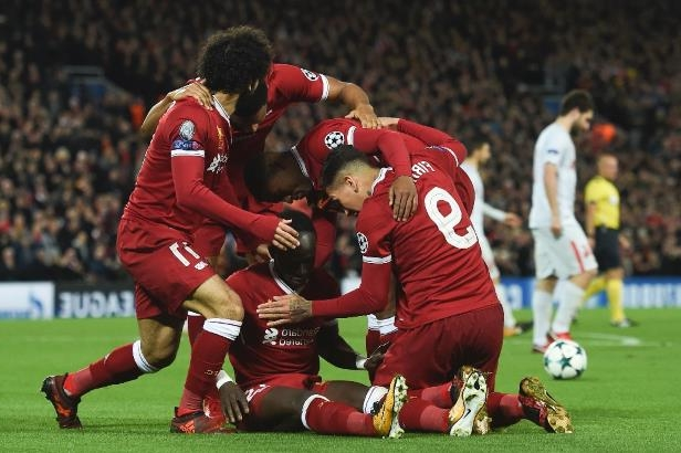 Liverpool's Sadio Mane (C) celebrates scoring their fourth goal during their match against Spartak Moscow in Liverpool, north-west England on December 6, 2017
