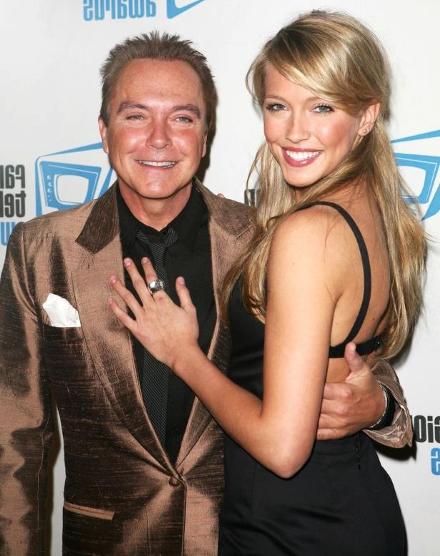 Katie Cassidy, David Cassidy posing for the camera