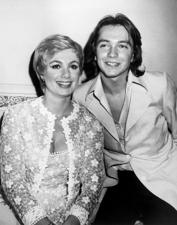 Slide 5 of 14: <p>Cassidy (pictured with Shirley Jones) became the biggest star of Partridge Family and began a solo career long before the series came to an end in 1975.</p>