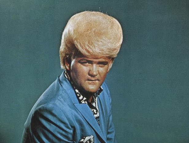 Slide 8 of 181: MIAMI - CIRCA 1960s:  Flamboyant soul singer Wayne Cochran poses for a publicity shot circa the mid-1960s in Miami, Florida.  (Photo by Michael Ochs Archives/Getty Images)