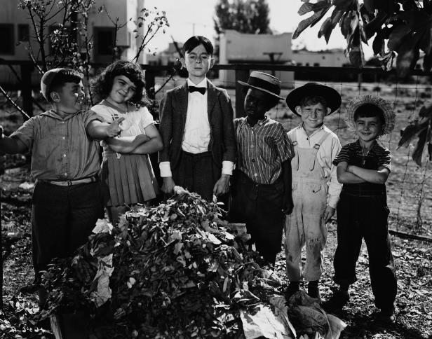 Slide 85 of 181: Spanky and the other gang members proudly show Cornelius Smythe, whom they think is Alfalfa, the clean yard. Gang members from left: Mickey (Robert Blake), Percy (Leonard Landy), Buckwheat (Billie Thomas), Cornelius Smythe (Carl 'Alfalfa' Switzer), Darla (Darla Hood), and Spanky (George McFarland). (Photo by �� John Springer Collection/CORBIS/Corbis via Getty Images)