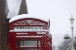 Snow disrupts road, air travel in England and northern Wales