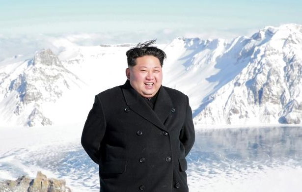Kim Jong-un standing on top of a snow covered mountain: The state-run Korean Central News Agency shows North Korean leader Kim Jong Un visiting Mount Paektu in an undated photo released Saturday. (AFP/Getty Images)