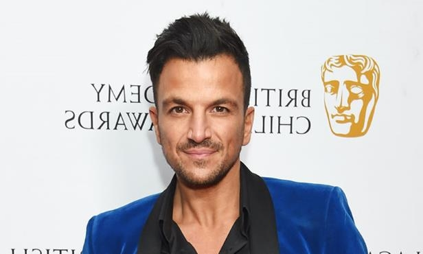 Peter Andre smiling for the camera: Hello! Magazine