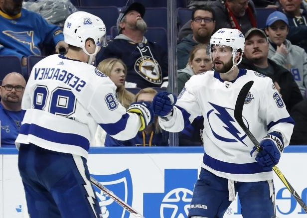 Nikita Kucherov is congratulated by Lightning teammate Mikhail Sergachev after scoring during the third period against the Blues.