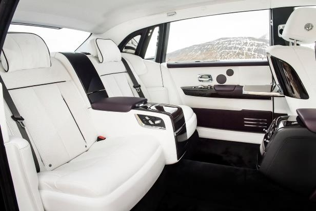 Slide 33 of 77: 2018-Rolls-Royce-Phantom-VIII-Extended-Wheelbase-rear-seat-02.jpg