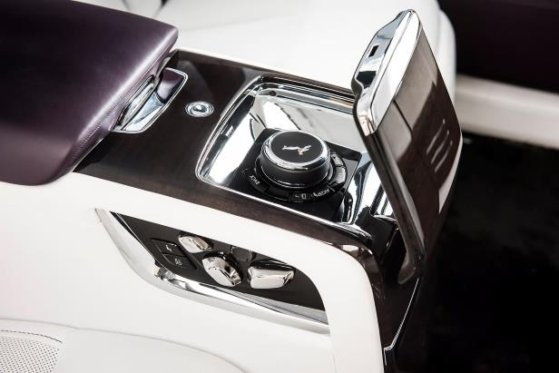 Slide 37 of 77: 2018-Rolls-Royce-Phantom-VIII-Extended-Wheelbase-rear-console-03.jpg