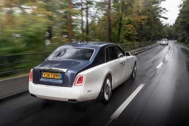 Slide 71 of 77: 2018-Rolls-Royce-Phantom-VIII-rear-three-quarter-in-motion-01.jpg