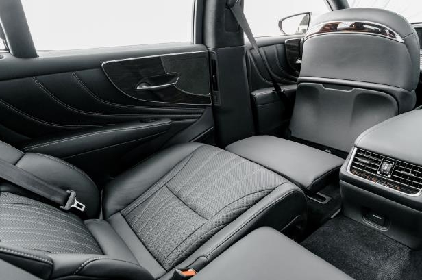 Slide 37 of 146: 2018-Lexus-LS-500-rear-seat-reclined.jpg