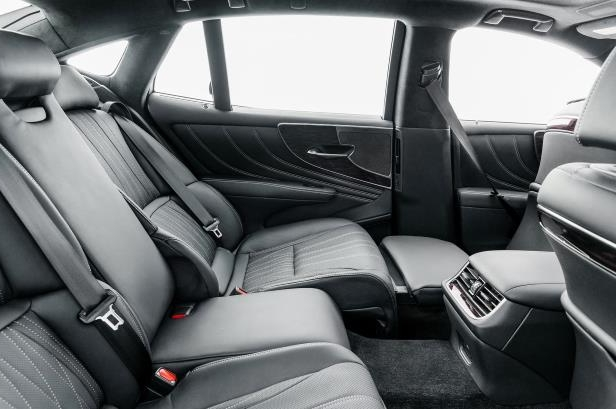 Slide 40 of 146: 2018-Lexus-LS-500-rear-interior-seat-reclined.jpg
