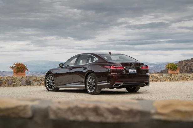 Slide 54 of 146: 2018-Lexus-LS-500-AWD-rear-three-quarter.jpg