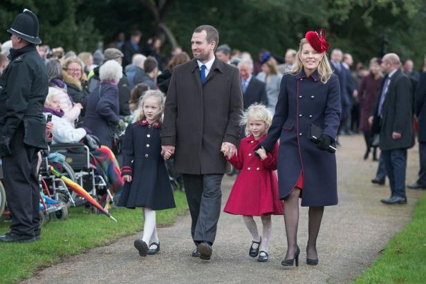 Slide 7 of 20: Autumn Patricia Phillips and Peter Phillips with their children Isla and Savannah (right) at the Christmas Day morning church service at St Mary Magdalene Church in Sandringham, Norfolk. 25 Dec 2017