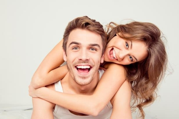a man and a woman posing for the camera: The Single Best Way to Revitalize Your Marriage