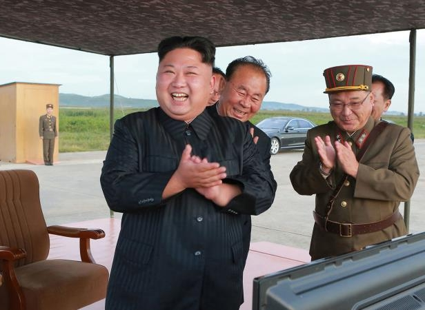 "FILE - In this undated file photo distributed on Sept. 16, 2017, by the North Korean government, North Korean leader Kim Jong Un, right, celebrates what was said to be the test launch of an intermediate range Hwasong-12 missile at an undisclosed location in North Korea. North Korea says it will never give up its nuclear weapons as long as the United States and its allies continue their ""blackmail and war drills"" at its doorstep. Independent journalists were not given access to cover the event depicted in this image distributed by the North Korean government. The content of this image is as provided and cannot be independently verified. (Korean Central News Agency/Korea News Service via AP, File)"