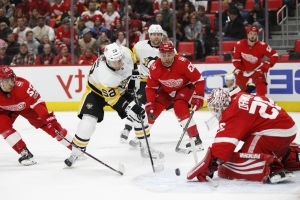 Safe at home: Red Wings pound Penguins