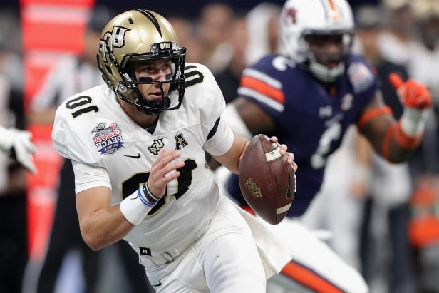 McKenzie Milton #10 of the UCF Knights looks to pass in the first half against the Auburn Tigers during the Chick-fil-A Peach Bowl at Mercedes-Benz Stadium on January 1, 2018 in Atlanta, Georgia.