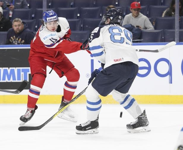 Filip Chytil of Czech Republic shoots the puck past Urho Vaakanainen of Finland during the first period of play in the IIHF World Junior Championships quarterfinals.